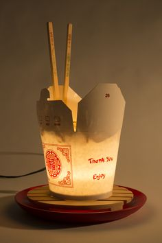 Asian wok take away box with varnished noodles and chopsticks.