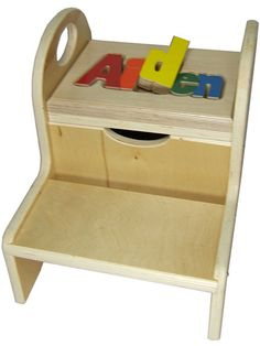 """Reach for the stars or for the sink! Our Personalized Two Step Storage Stool from Hollow Woodworks has an 11"""" total height. The top step flips open to reveal storage space for special treasures, and handles at either side mean young ones can easily move the stool from place to place and each stool is handmade just for you. $80"""