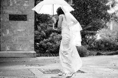 Wedding photo locations Perth: UWA University of Western Australia. Bride caught i the rain with umbrella. Photography by DeRay & Simcoe.
