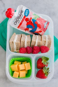 Keep your little superhero going strong all day with this protein packed breakfast-for-lunch box: Leftover pancakes spread with a little cream cheese. Cheese cubes, fresh berries and a /chobani/ Kids Spiderman Pouch. An easy but nutritious lunch that they Kids Packed Lunch, Kids Lunch For School, Healthy School Lunches, Kids Cold Lunch Ideas, Bento Box Lunch For Kids, School Ideas, Lunch Box Recipes, Lunch Snacks, Baby Food Recipes