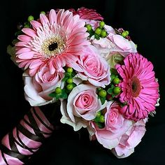 Gerbera Daisy and rose boquet.  Darker Watermelon Pink colors with blue satin ribbon.
