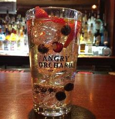 ANGRY CRISP MOJITO made with 1oz. white rum, 4 slices of strawberry, a couple blueberries, 4 mint leaves, and 6oz. of Angry Orchard Crisp Apple over ice