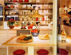 "When Rosanne Hirsch and her husband, Barry, a film producer, commissioned architect  Alan Buchsbaum to design this 1981 kitchen, they requested that it not be standard in any way. ""When I come home from the office, I want to be in spaces that are fun to be in,"" Roseanne Hirsch said. The kitchen sported lacquered cabinets, glittery brass, and large expanses of glass and mirror.   - HouseBeautiful.com"