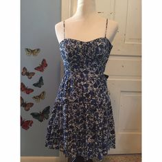 Blue Floral Tulle Dress Beautiful floral B Darlin dress with tulle. Unzips on the side   Measurements - Bust 14in / Length 24in / Underband 12 1/2in   Please know your bust size and measure yourself before purchasing to be sure this item will fit you. B Darlin Dresses Midi