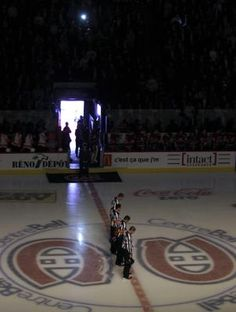 The Montreal Canadiens turned down the lights for a moment of silence for the victims of the Boston marathon tragedy prior to their NHL hockey game against Philadelphia Flyers in Montreal, April 15, 2013. REUTERS/Christinne Muschi (CANADA - Tags: SPORT ICE HOCKEY)  #BostonStrong