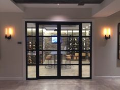 Metal and glass entry into this custom wine room w distressed barn wood, slate, climate control and led lighting Glass Wine Cellar, Wine Cellar Design, Wine Glass, Wine Cellar Basement, Just Wine, Climate Control, Wine Collection, Wine Cabinets, Wine Racks
