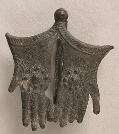 Pilgrim Badge, Thomas A'Becket's Gloves, 15th century, Bury St. Edmunds, England, tin and pewter.