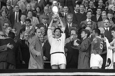 22/05/1963 Wembley. European Cup Final. Milan-Benfica. Cesare Maldini lifts the first European Cup for Ac Milan watched by Gianni Rivera and Benfica captain Mario Coluna.