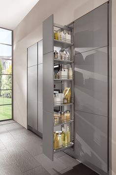 German Kitchen Design / Nobilia Collection - The harmonious union of aesthetics and functionality: LINE N tall unit with larder pull-out and vertical recessed handles. www.germankitchencenter.com