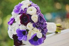 Disney wedding at the Disneyland hotel - bride's bouquet of white and purple flowers