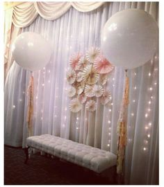 Giant balloons, balloon tassels, fairy lights, paper rosettes for a photo back drop. LOVE this!!