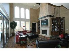 The gorgeous two story #fireplace adds something very special. www.cctulsa.com