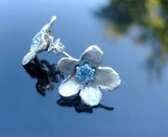 Sterling silver cape primrose studs set with blue topaz