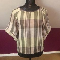 Free People Short Sleeve Plaid Double Cloth Top Lightweight, slightly cropped top in a pale green and blue plaid. Buttons up the back and wide rolled sleeves. In good condition but has a couple tiny pulls that are hardly noticeable. 100% cotton. Free People Tops Blouses