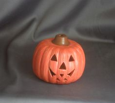 """This ceramic Jack -O- Lantern is hand painted with acrylic paint and then sealed. The eyes have been carved to allow the light from a battery operated tea light to shine through. It stands 3 ½"""" tall and 4"""" in diameter. Makes a great Halloween decoration. ..."""