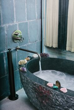 Gorgeous bathtub and tiles giving outdoors look and feel to bathroom