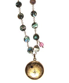 """Circa 1900, 14K Locket with Ruby and Stars on Black Abalone with Cranberry Tourmalines on gold filled chain. Necklace length 16 1/2""""- 21"""" inches. Pendent length 1 3/4"""" inch. Pendent width 1"""" inch. Lobster clasp. Made in USA.  www.thesagelifestyle.com"""