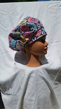 Check out this item in my Etsy shop https://www.etsy.com/listing/279012762/multicolored-floral-bouffant-style-scrub