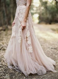 A blush-colored wedding dress with gorgeous lace details is so right for an outdoor ceremony.