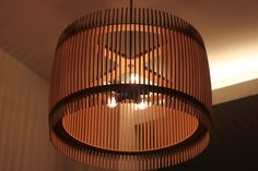 Beautiful round light fixture set in a hallway. Made out of laser cut mdf. Clean, sleek and modern