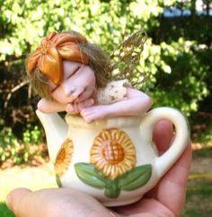 Tea Leaf Fairy in a Sunflower Teapot   http://cgi.ebay.com/ws/eBayISAPI.dll?ViewItem=150866149647