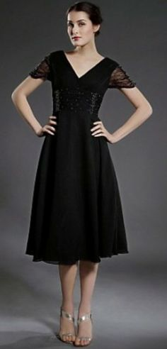 mother of groom dress?  maybe in charcoal or plum?