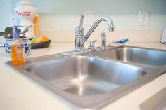Shine up your stainless sink using Barkeeper's Friend.