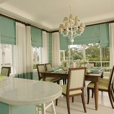 love how glass windows brings in natural light and freshness to the dining room.