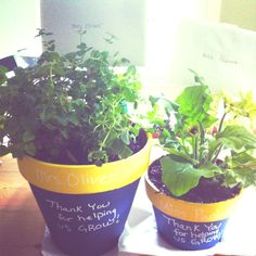 Chalkboard painted on flower pots. End of year gift for teacher - gift card attached to a ruler.