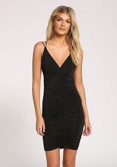 b6fed7b847 A sultry bodycon dress featuring a plunge V neckline with double cross  straps along the back. In a sheen stretch knit bodice with elastic and  ruched sides ...