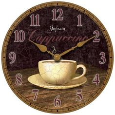 Kitchen clock features a picture of warm cappuccino cup with Arabic numbers encircling the dial