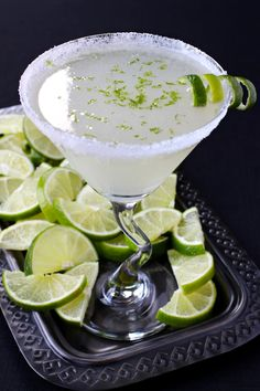 Lime Drop Martini replaces the classic lemon with lime. 3 ounces vodka 1 ounce triple sec 1 ounces fresh lime juice 2 teaspoons super fine sugar, plus extra for sugaring the rim of the glass lime zest, and a lime twist, for garnish Lime Drinks, Bar Drinks, Cocktail Drinks, Yummy Drinks, Beverages, Lemonade Cocktail, Detox Drinks, Lemon Drop Martini, Key Lime Martini