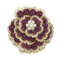 Ruby and diamond brooch, Vourakis, 1960s Of floral design, set with graduated cabochon rubies and brilliant- and single-cut diamonds