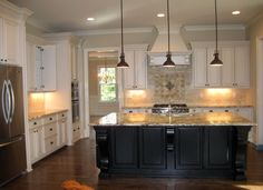 White kitchen with black island