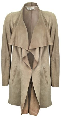 A stunning waterfall jacket in butter soft suede. Collarless waterfall front with tie fastening, two inset front pockets. Full length sleeves.…