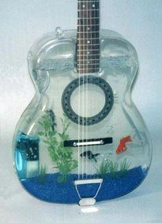 a guitar fish aquarium! Unique Fish Tanks, Cool Fish Tanks, Tropical Fish Tanks, Tropical Aquarium, Aquarium Design, Fish Aquariums, Aquarium Rocks, Fish Tank Design, Hipster Decor