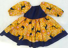 This Girls Peasant Dress is my new favorite! So fun in this woodland themed fabric with navy blue deer on a yellow ochre or mustard base. There is small florals in background as well in orange, Reds, and Aqua. Perfect spring or summer colors made to order in designer fabric. Your little one will love the circle skirt twirl factor. Made in a complete circle, she can twirl all day!! This peasant dress would be great for school pictures or any professional photo shoot! It has a navy blue bodice…