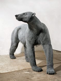 Kendra Haste captures the spirit and movement of wild animals wire mesh sculpture