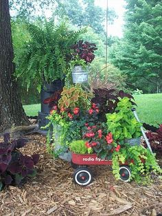 repurposed junk garden, gardening, repurposing upcycling, Radio flyer wagon washtub and an old heater repurposed as a plant stand Garden Junk, Lawn And Garden, Garden Pots, Garden Wagon, Spring Garden, Garden Whimsy, Glass Garden, Magic Places, Recycled Garden