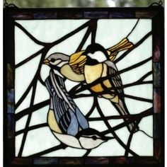"""Chickadee Window:   #149 68387. $179.99. Chickadee Stained Glass Window. Bark Brown branches across a Azure sky make a pleasant repose for these often seen backyard bird, early morning visitors. A original design, handcrafted utilizing the copperfoil construction process and stained art glass. The artwork is set in a solid brass frame with included mounting bracket and jack chain .Measures 18""""W x 18""""H. http://www.thecabinshop.com/"""