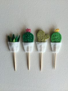 Set of 12 cactus/succulent felt cupcake toppers (3 of each design)  Cut, embroidered and assembled by hand (made to order)  Perfect for bridal showers, garden parties, weddings, and birthdays!  Measures approx. 3 - 3.25 tall (toothpick and decoration)  If you need a different amount or would like to customize the designs, please send me a convo and Ill be happy to help