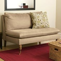change the legs to brass and tuft the seat cushion in a minimal pattern