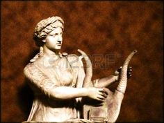 Ancient statue of woman playing the harp Stock Photo