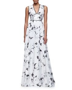 """Lela Rose metallic floral-print gown with contrast trim. Approx. length: 65""""L down center back. V neckline. Sleeveless; moderate shoulder coverage. Fitted bodice; A-line skirt. Hem falls to floor. Hid"""