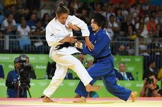 Kosovos Majlinda Kelmendi competes with Japans Misato Nakamura during their womens 52kg judo contest semifinal B match of the Rio 2016 Olympic Games in Rio de Janeiro on August 7 2016 AFP Toshifumi KITAMURA.jpg (1600×1067)