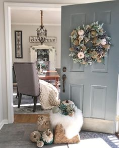 Front door color BM Sea Pine; also love the pumpkins with feathers on top