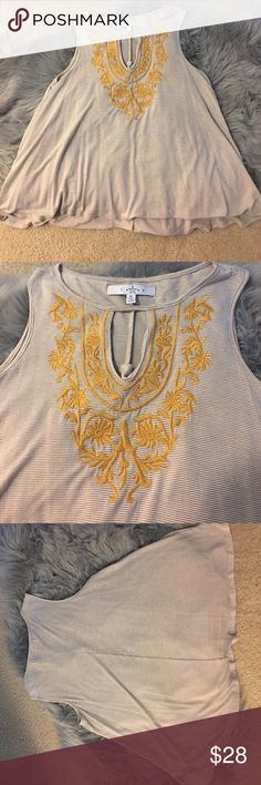 Top Sleeveless with embroidery on the neck close to the chest size is small . Have been worn once Tops Tank Tops