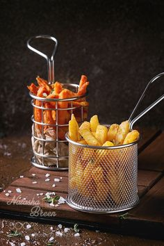 Variety of french fries by NatashaBreen from http://500px.com/photo/213408253 - Variety of french fries traditional potatoes sweet potato carrot served in frying basket with salt thyme on wooden board over brown texture background. Homemade fast food. More on dokonow.com.