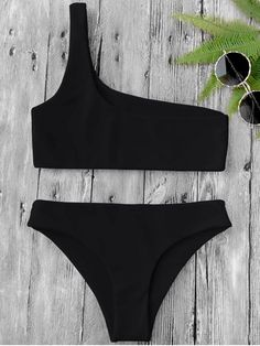 AD : One Shoulder Bikini Set - BLACK Contemporary asymmetric bathing suit featuring single shoulder pullover bikini top and hipster swim bottoms, non-padded. Swimwear Type: Bikini Gender: For Women Material: Nylon,Polyester,Spandex Bra Style: Bralette Support Type: Wire Free Collar-line: One Shoulder Pattern Type: Solid Waist: Low Waisted Elasticity: Elastic Weight: 0.2000kg Package: 1 x Top 1 x Bottoms