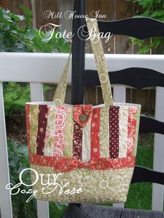 Strippy tote bag with button loop closure.  No pockets, but I ALWAYS add pockets.  Moda Bake Shop downloadable PDF.